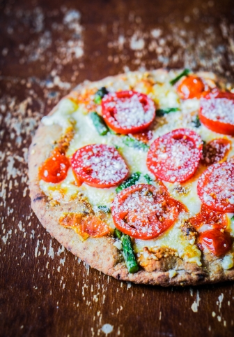 Ancient pizza with tomatoes and asparagus